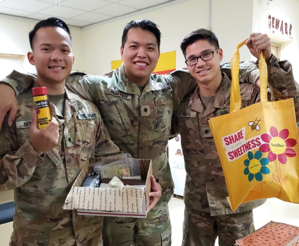 Photo of U.S. service members with care package from Sioux Honey.