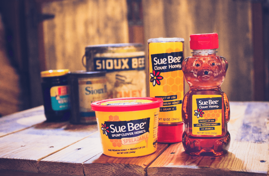 Photo of Sue Bee® honey containers.
