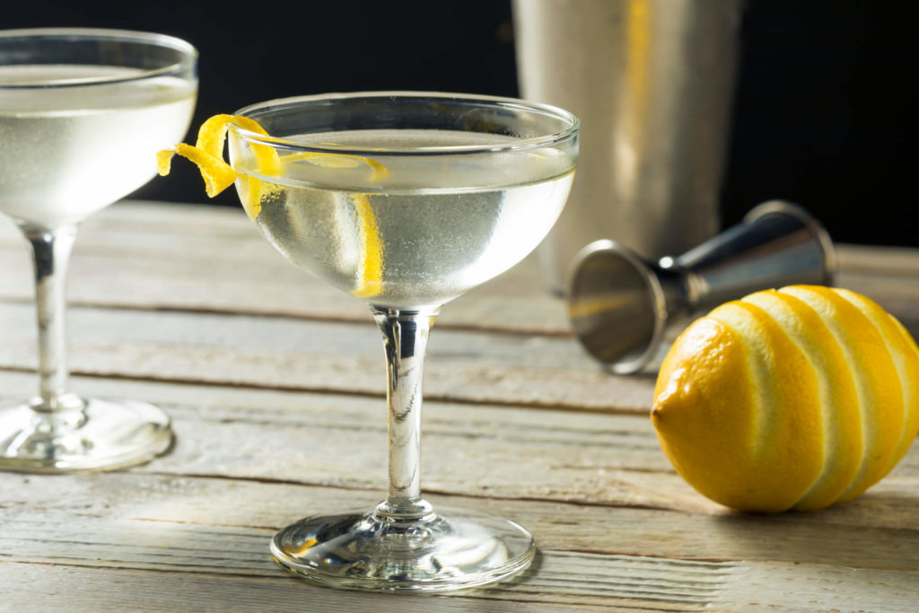 Photo of a cocktail with a lemon twist.